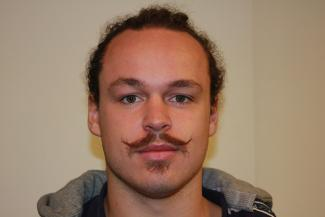 Student Jake Robey with his moustache