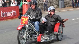 James May and Oz Clarke riding the Meccano bike