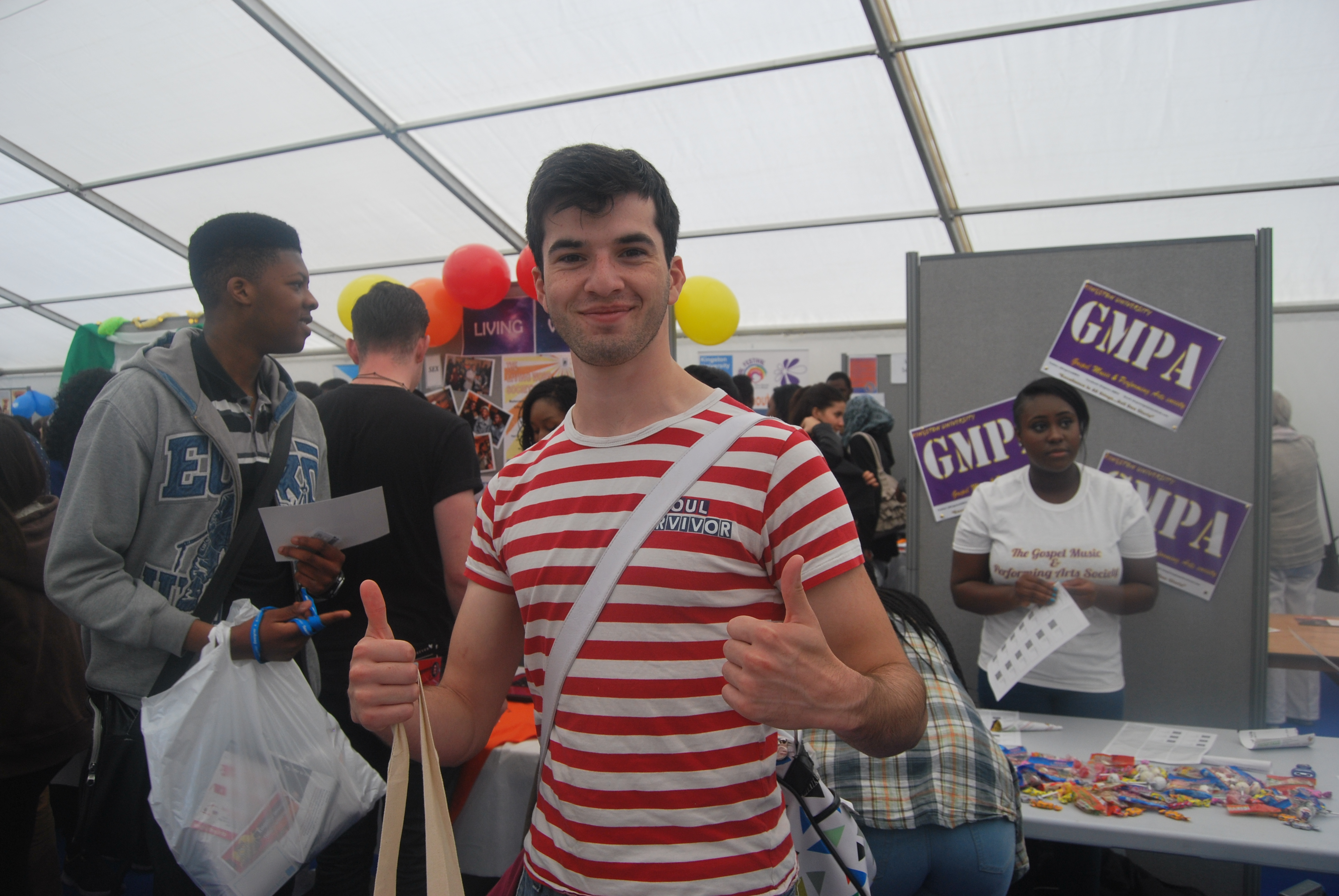 One happy student give thumbs up to the Fayre