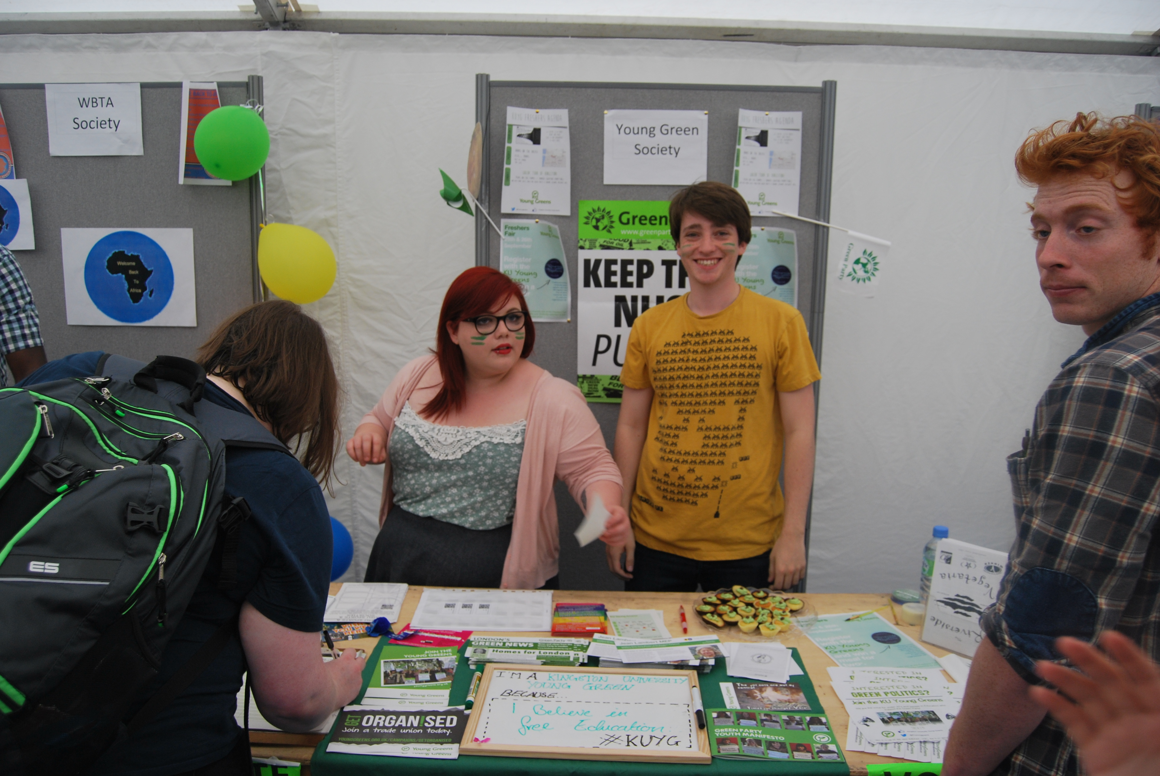 The Young Green Society smile as another signs up