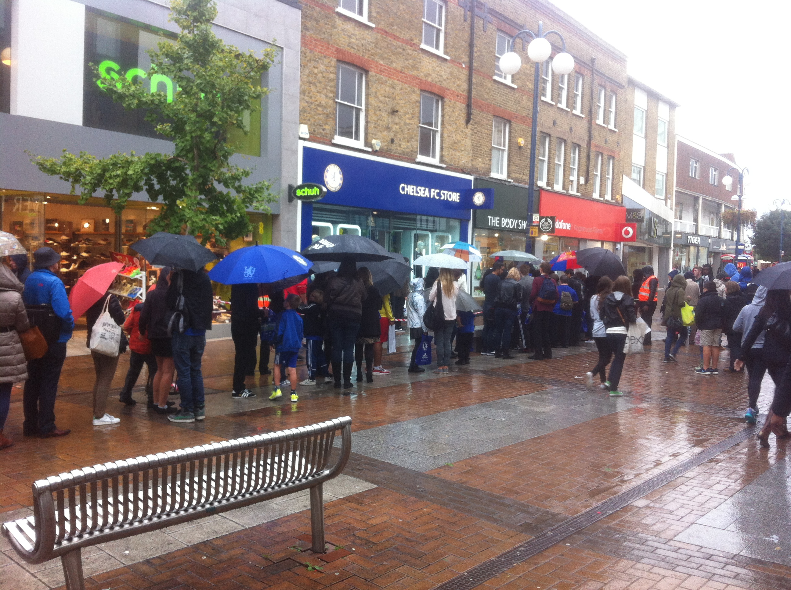 Disappointed Chelsea fans lining up in the rain