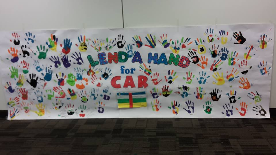 The week began with the creation of the 'Lend a hand for CAR' poster where every hand donated a £1. Photo by Nasreen Uddin