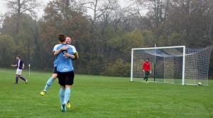 KU captain Gareth Chendlik receives appraisal after penalty goal. Photo: Abby Ward