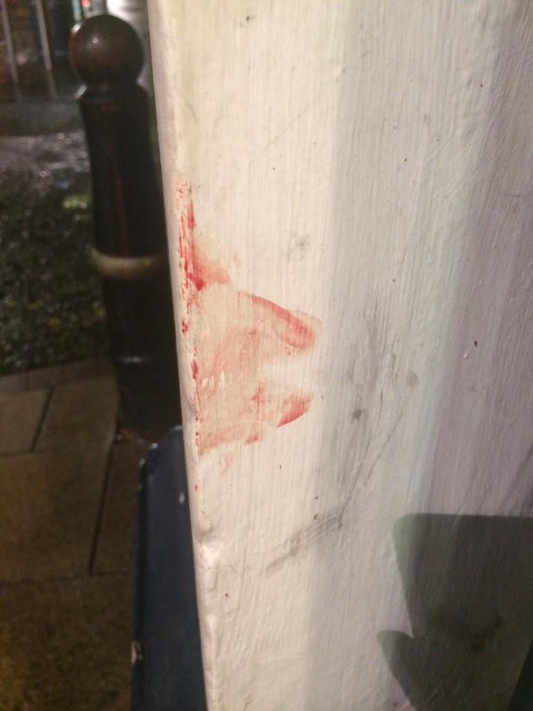 Blood on the wall of Feather & Black furniture store. Photo: Martine Mæland