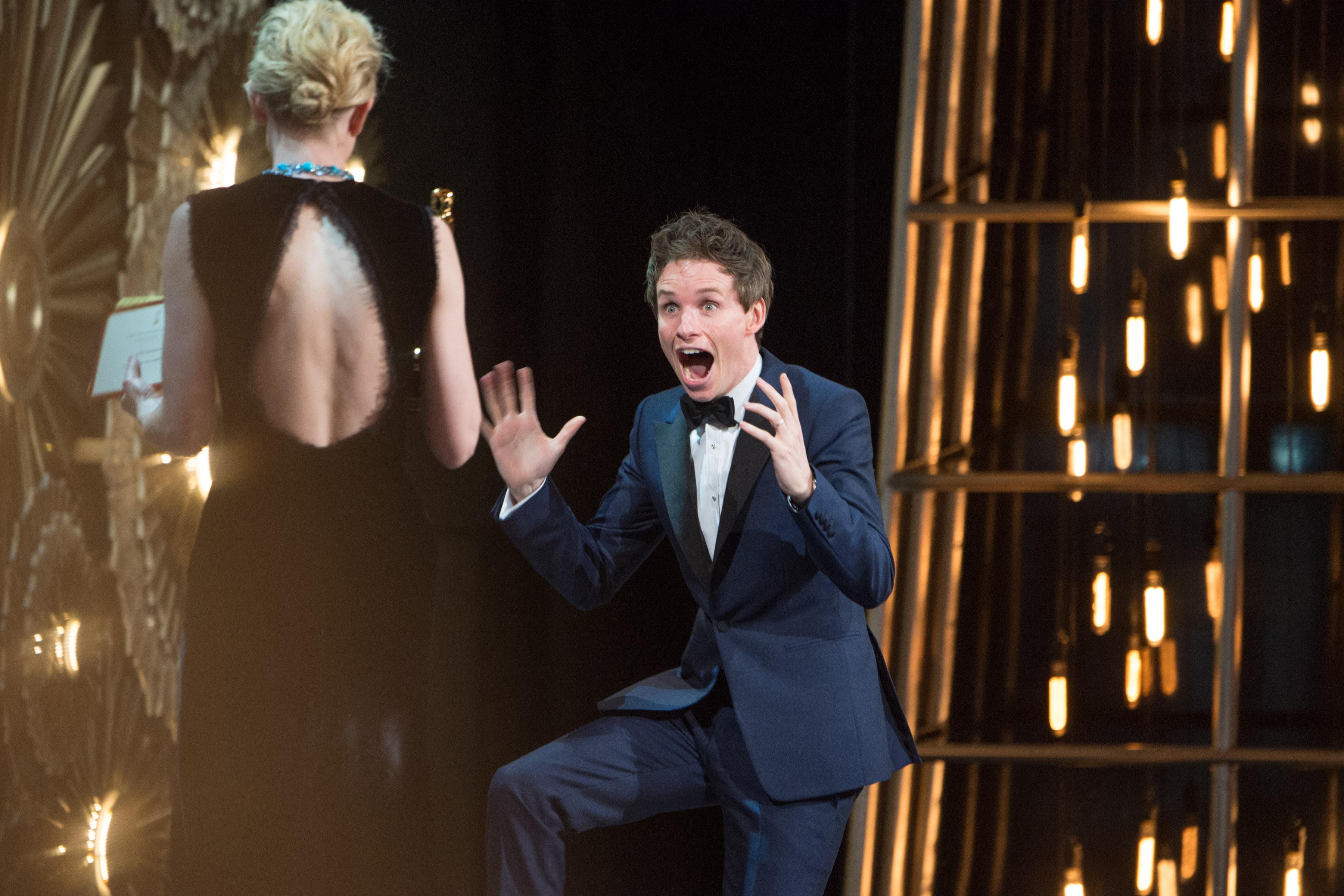Eddie Redmayne accepts his Oscar. Photo: REX