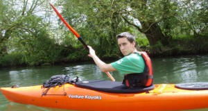 Chris Fox kayaking on the river