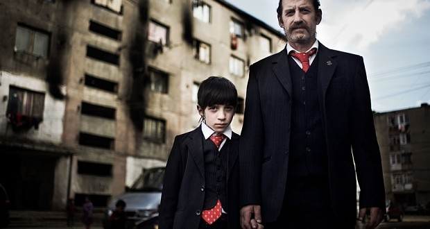 Sandu and his son Antonio outside the apartment block they live in.  Credit: Channel 4