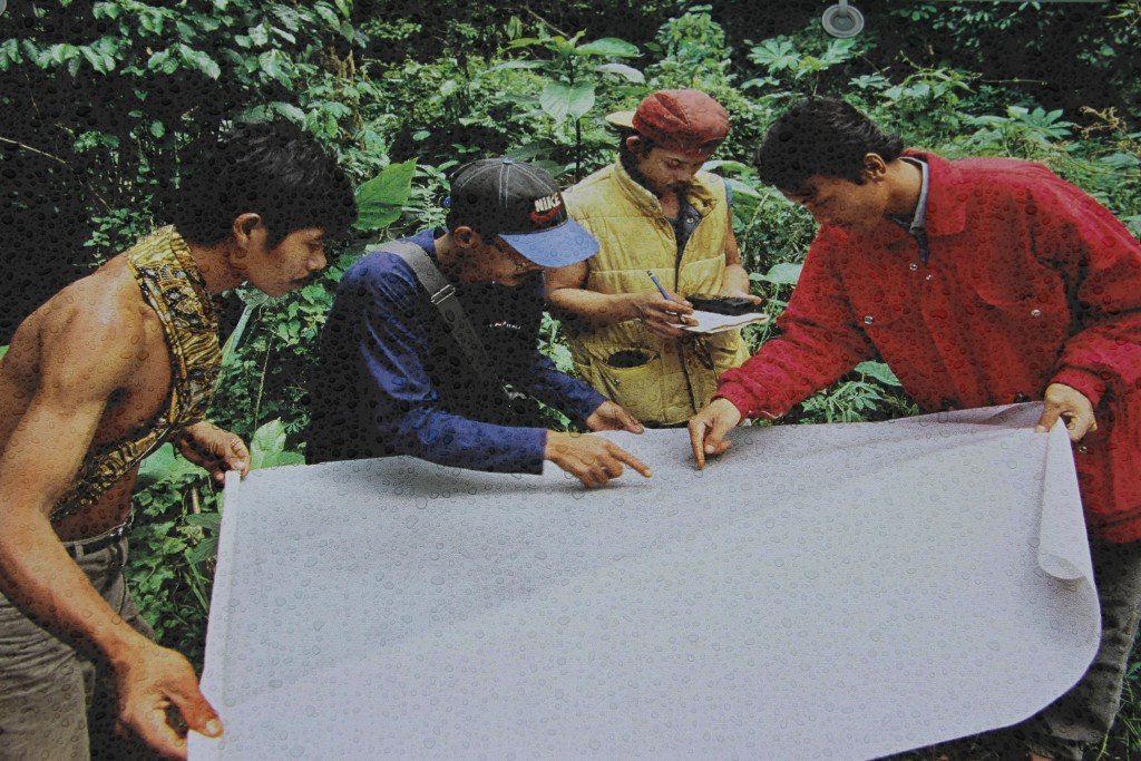 Kubu tribesman in Indonesia mapping their area to help prevent illegal logging