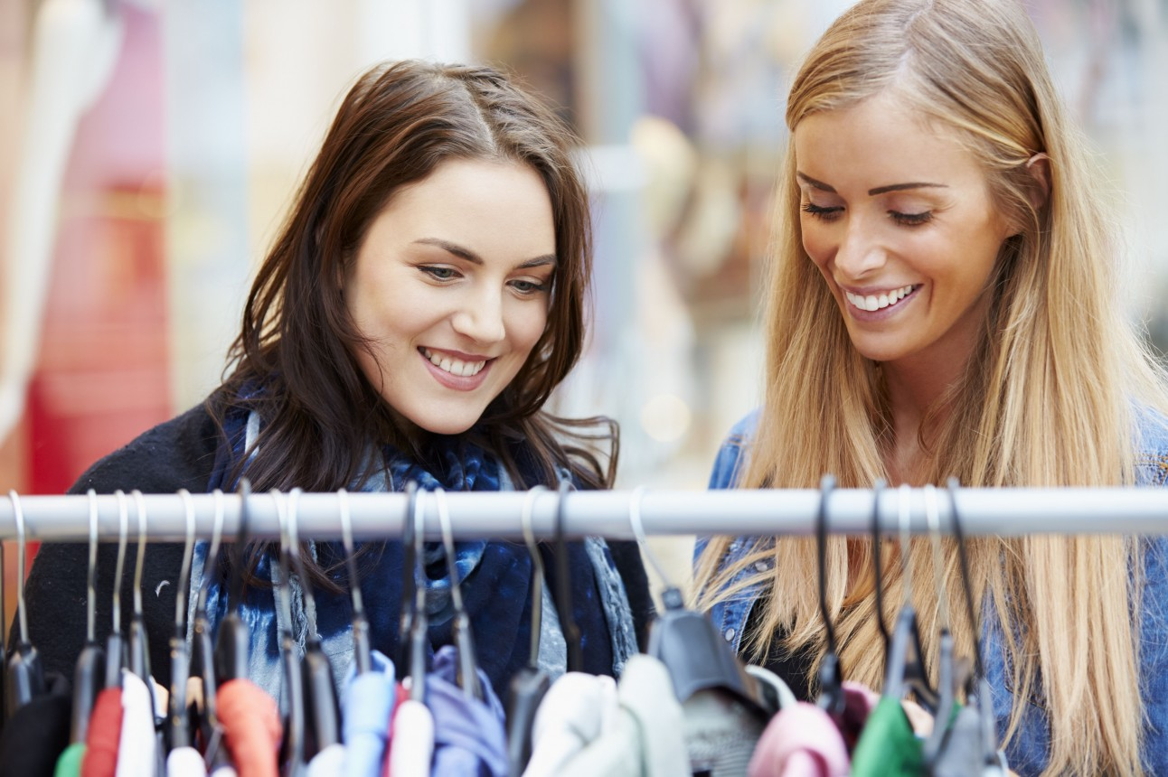 Women looking at clothes- REX Features