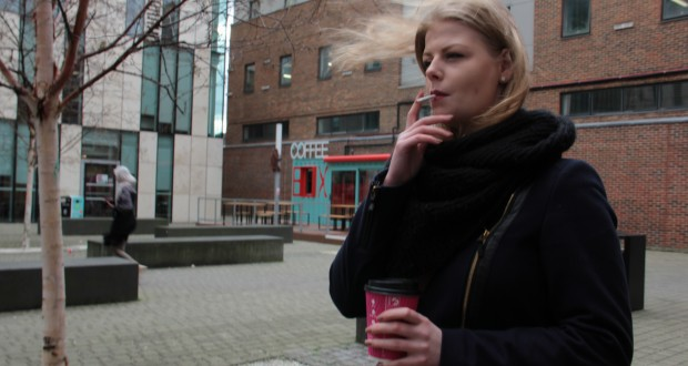Students continue to smoke in the courtyard despite the recent ban