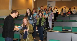 Readers stand in line to have their copies of The Humans signed by author Matt Haig