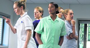 Performers embracing their nursing roles during 'Careful' performance Photo Credit: Anna Tanczos