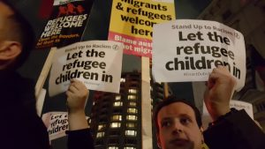 Protesters held placards welcoming refugees.