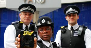 Police officers showing the new body cameras and how they will be worn. Photo credit: Metropolitan Police Press Office