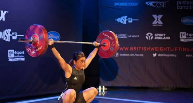 Fakcha performing the clean and jerk exercise at the British Junior Championships