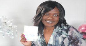 Neomi Banett holding her life-saving product Neo-Slip.