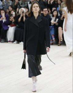 You could just borrow your boyfriend's jacket to get that same, oversized Céline look. Photo: Rex Features