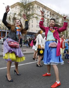 Young women brightly dressed for a parade. Credit: Rex Features, Vladimir Sindeyeve