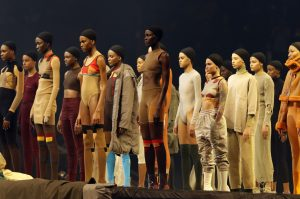 Models style Yeezy clothes at Kanye West fashion show. Photo by Bruce Barton/AP/REX/Shutterstock