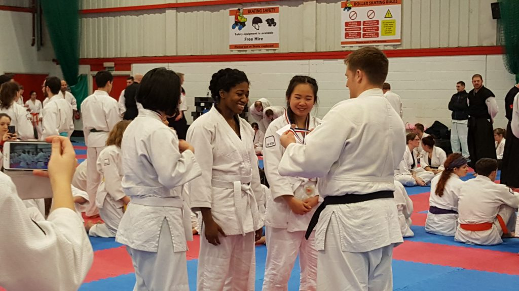 Sochima Okoye (second from left) won gold in her female white belt category. Photo Credit: Charles Jean Boucher