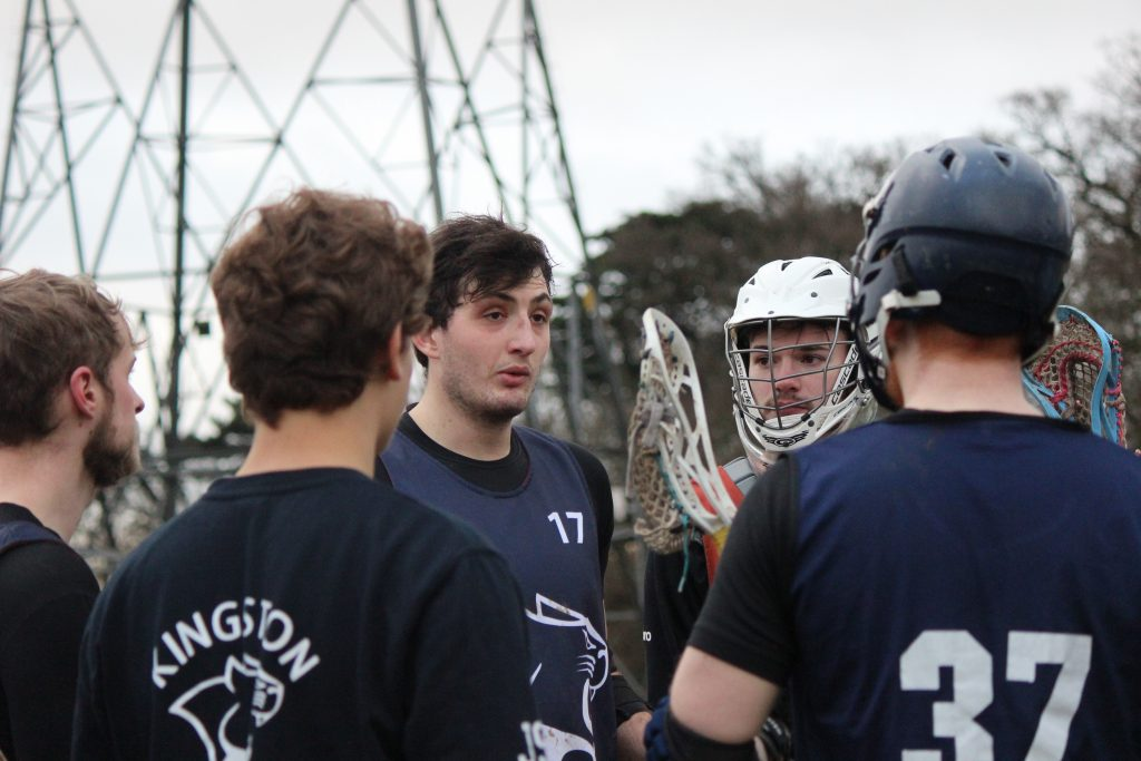 Captain Rob Nicoll (17) and vice captain Zachary Fountain (white helmet) speaking to the team at half time. Credit: Shani Kotecha