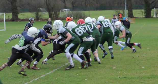 Kingston Cougars charging at the Swansea Titans Photo: Carlos Nobrega