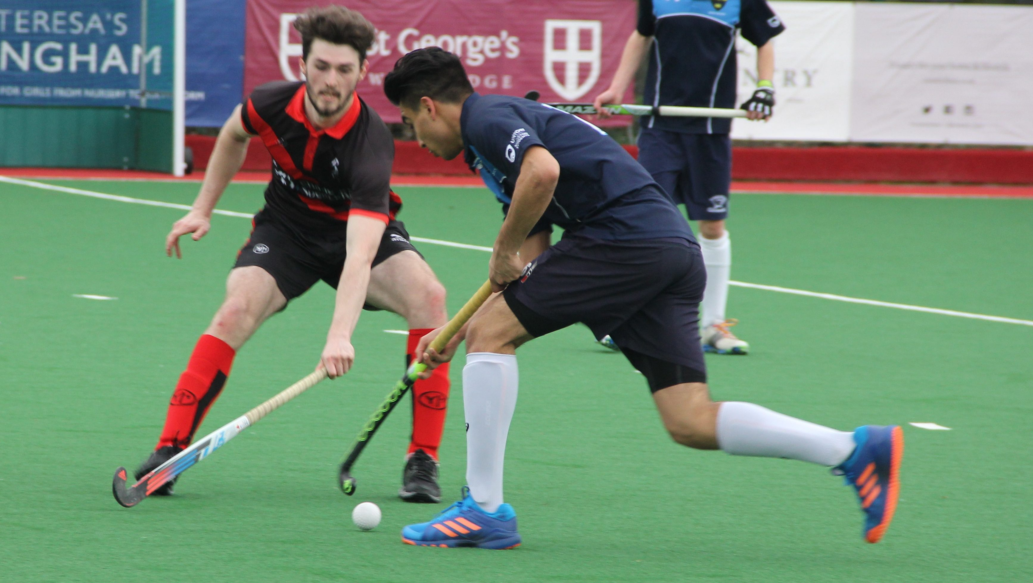 Kingston men's hockey side remain top of the table with just three games left to play. Photo Credit: Soile Ntutu