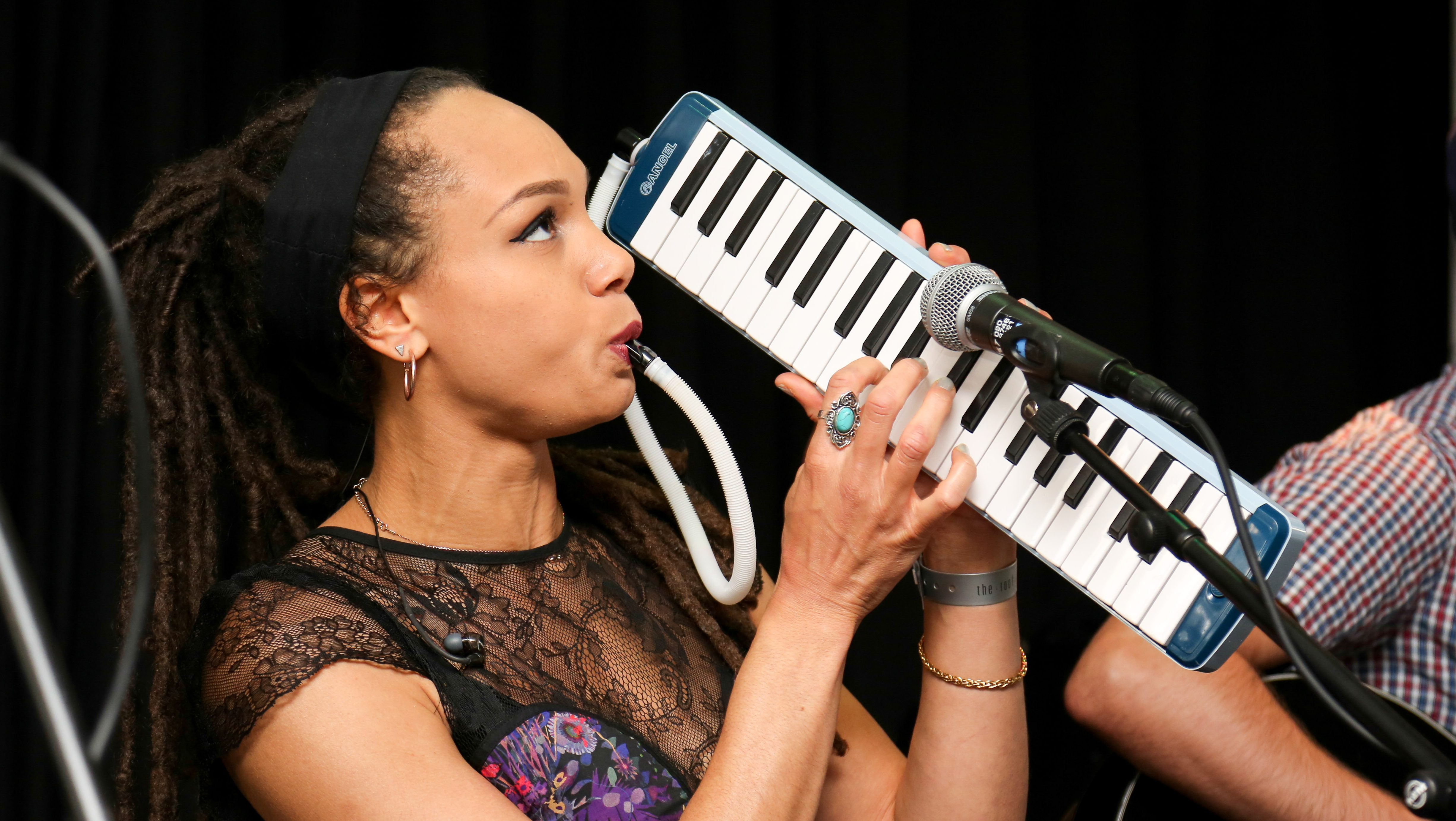 Marcia Richards playing the melodica. Photo Credit: Rex