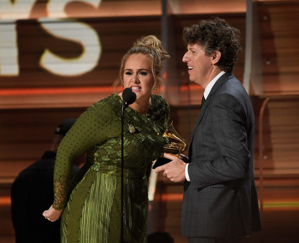 Photo by ddp USA/REX Adele receives Record of the Year along with Greg Kurstin
