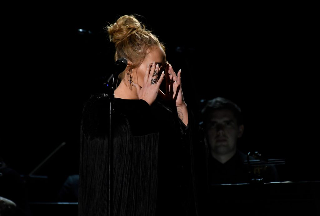 "Photo by ddp USA/REX Adele composes herself during the George Michael Tribute after ""messing up."""