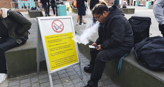 KU Student Smoking E-Cigarette in JG Courtyard