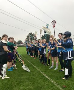 The team spirit was high when the lacrosse women met Royal Holloway (left).