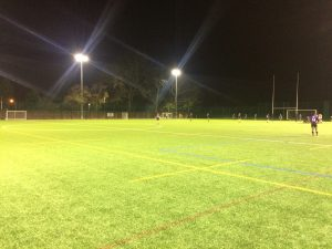 With the light all but gone when the teams kicked-off, they were forced to play on a harsh 3G surface. Photo: Louie Chandler