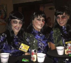 A group of partygoers dressed as a zombie flight crew from the crash Photo: Daily Mail
