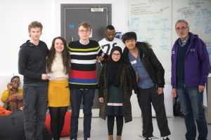 The winning team from left to right: Richard Burton (games programming), Rhian Betty (adult nursing), Matthew Tomlinson (graphic design), Nasima Begum (pharmacy) , Albert Condino (aerospace engineering) with David Edmonds (Chair of Governors). Source: Kingston University Enterprise Department