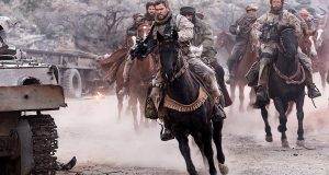 Captain Mitch Nelson (Chris Hemsworth) riding into battle Photo: REX