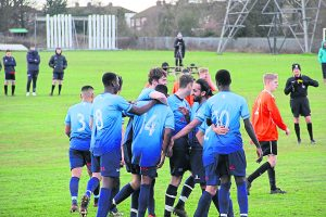 Ross opens the scoring for KUFC and is mobbed by his teammates Photo: Louie Chandler