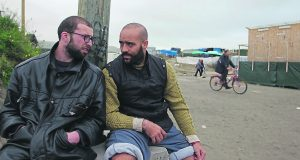 Jubeh [left] plays the role of a refugee living in the Calais jungle Photo: Lisa Lovett