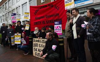 Lecturers gather outside Penhryn Road to protest against pay cuts
