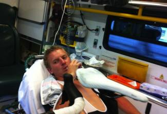 Josh Dines was rushed to hospital after a collision with another cyclist
