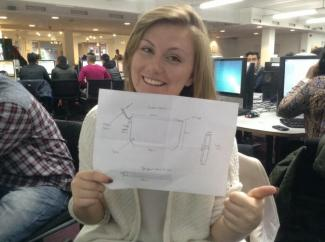 Rosie Hall holds up a rough sketch of upcoming product