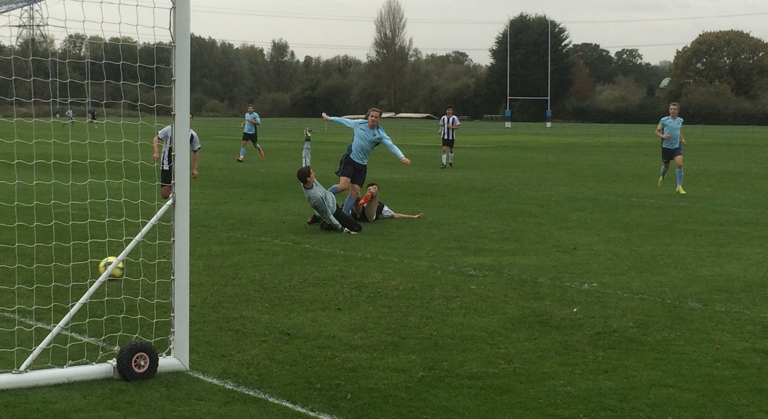 Sam Pledger curls the ball past the keeper