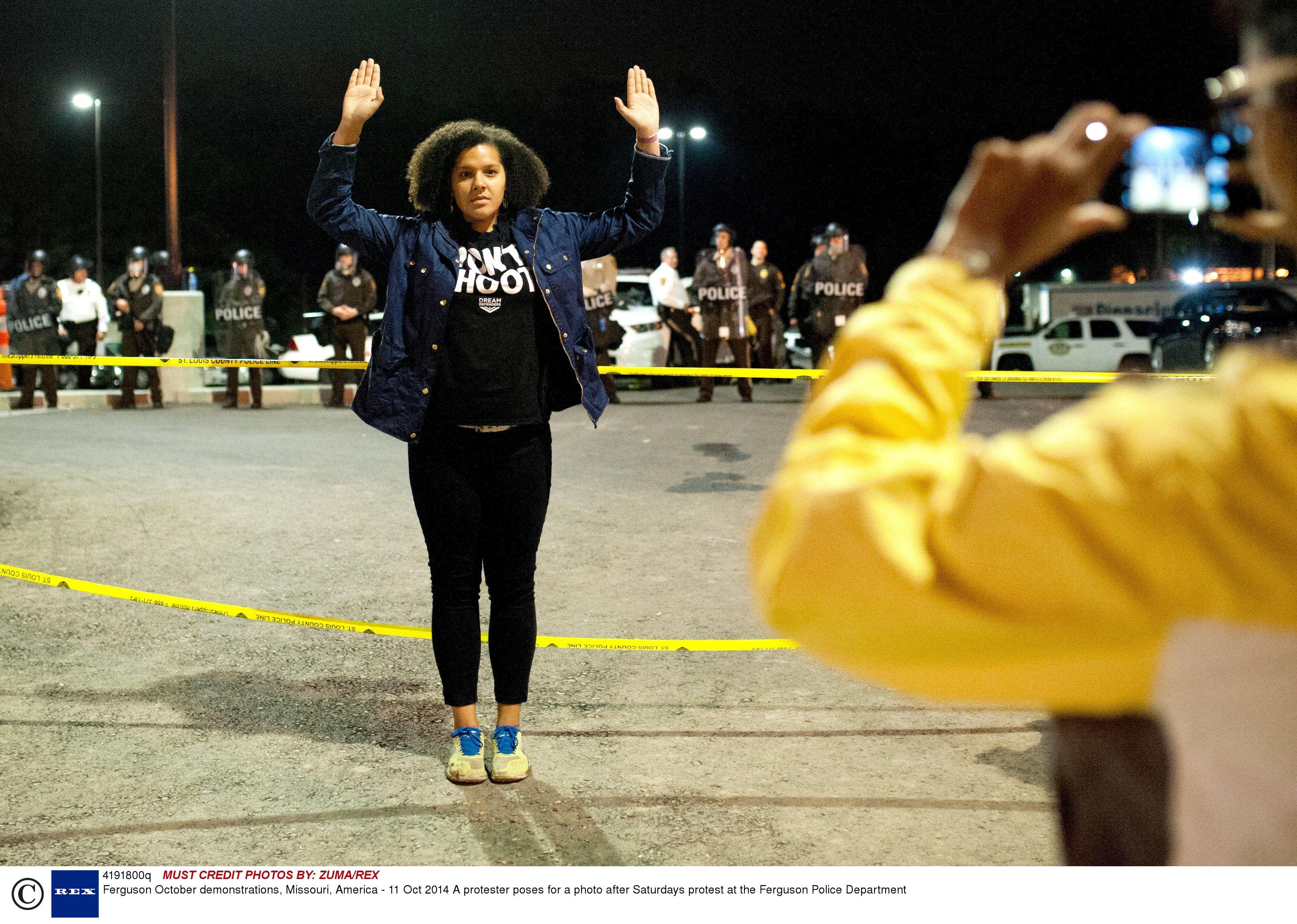 'Hands up, don't shoot' symbol in Ferguson - copyright Rex Features
