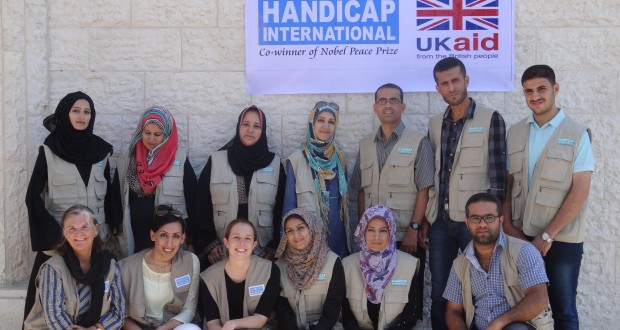 KU lecturer Mary Jane Cole (bottom row, extreme left) traveled to war-torn Gaza to support amputee rehabilitation services [Image credit: Peter Skelton/Handicap International]