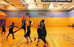 Kingston's male basket ball team beat Westminster and avoid relegation