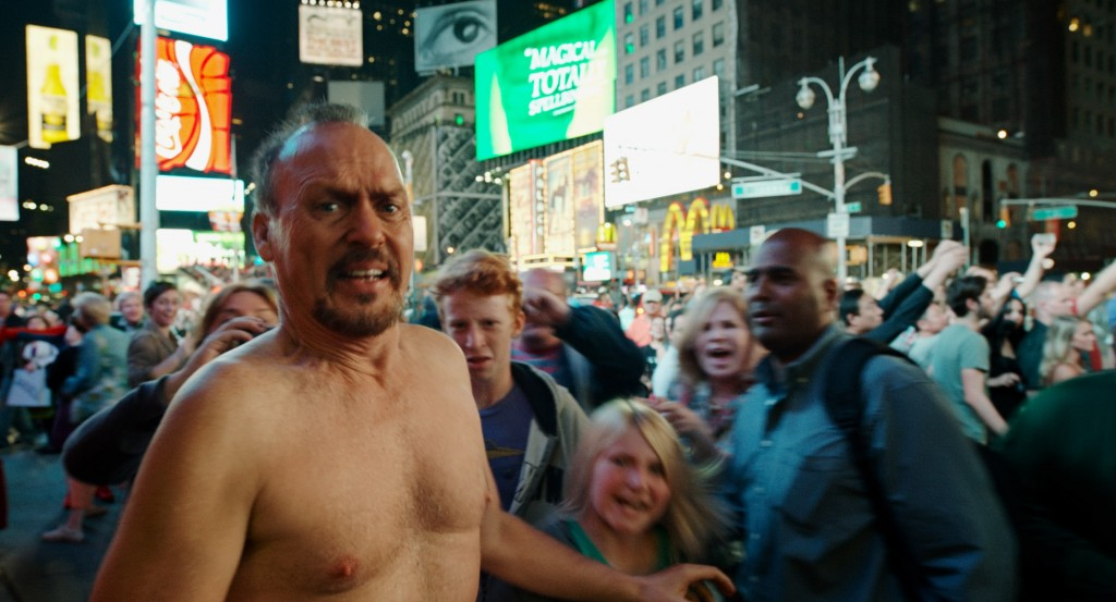 An almost nakedd Riggan Thomas running across a busy Times Square. Photo: Rex Features