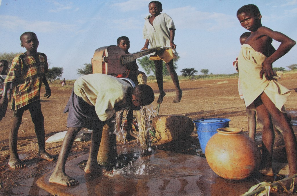 Children collecting water in Kalsaka village, Burkina Faso