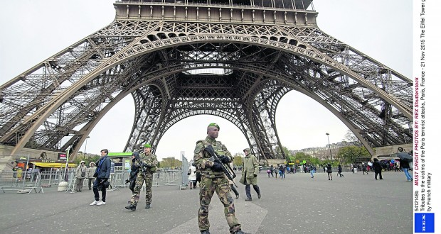Mandatory Credit: Photo by REX Shutterstock (5412148b) The Eiffel Tower guarded by French military Tributes to the victims of the Paris terrorist attacks, Paris, France - 21 Nov 2015