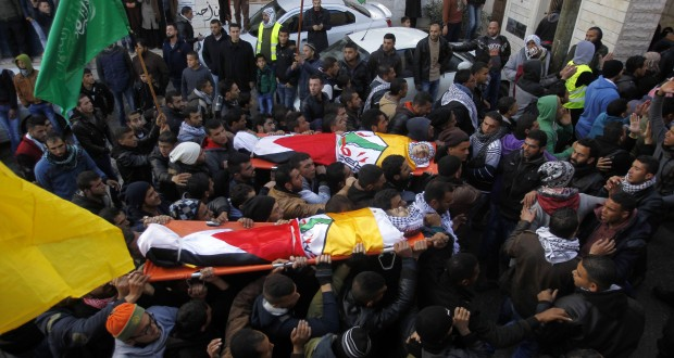 Photo by APAImages/REX/Shutterstock (5534049b) Mourners carry the bodies of four Palestinians, who were killed by Israeli security forces after they perpetrated attacks in the southern West Bank, during their funeral in the West Bank village of Sair Funeral of four Palestinians killed after attacking Israeli security forces, Sair, West Bank - 09 Jan 2016