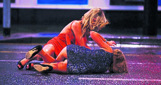 Mandatory Credit: Photo by REX/Shutterstock (1527579f) Two drunken young women lie in the middle of St Mary's Street New Year's Eve revellers in Cardiff, south Wales, Britain - 31 Dec 2011